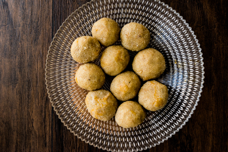 icli kofte  Boiled kibbeh  Quibe with butter sauce. Homemade Food.