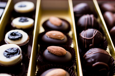 Assortment of Chocolates in box (selection focus)
