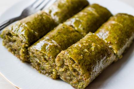 Turkish Dessert Pistachio Roll called Fistikli Sarma  Baklava. Traditional Deseert.