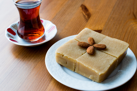Semolina Halva with Almonds cut in square. Traditional Food. Stock Photo