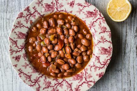 Bean stew  Turkish Barbunya Pilaki in a  plate (portion).