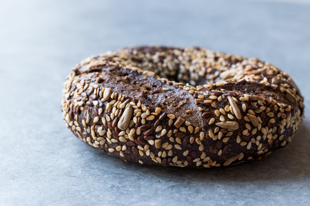 Healthy Organic Whole Grain Bagels with Chia Seeds and Sesame. Bakery Concept. Stock Photo