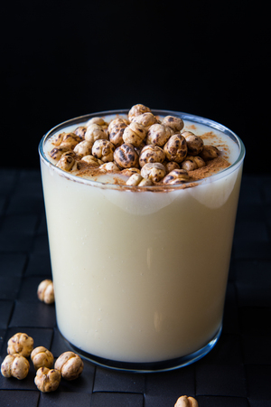 Boza or Bosa, traditional Turkish drink with roasted chickpea. Black backround