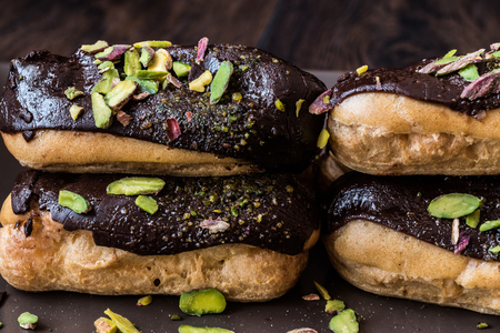 Chocolate Eclairs  Donut with pistachio powder Stock Photo