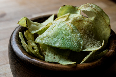 Wasabi Chips in a wooden bowl. Snacks Concept. Stock Photo