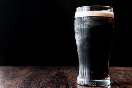 Dark Beer on wooden surface. Beverage concept.