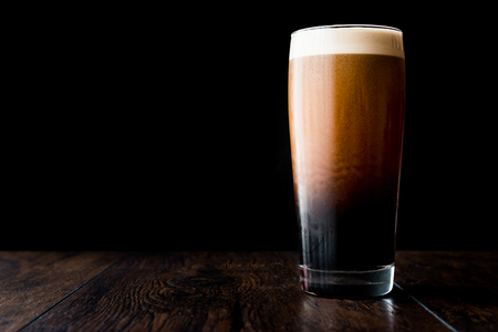 Dark beer on wooden surface. copy space. Beverage Concept. Stock Photo