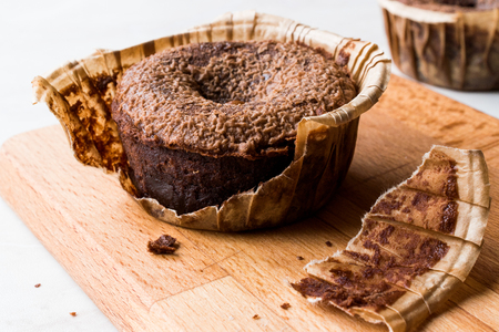 Hot Chocolate Cake Souffle on Wooden Surface. Dessert Concept. Stock Photo