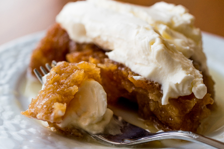 Turkish Dessert Ekmek Kadayifi  Bread Pudding with cream. Traditional Dessert Stock Photo