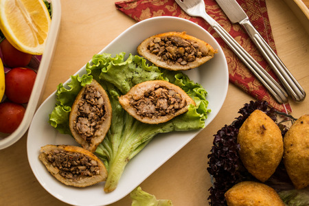 icli kofte  Fried kibbeh  Quibe with butter sauce.