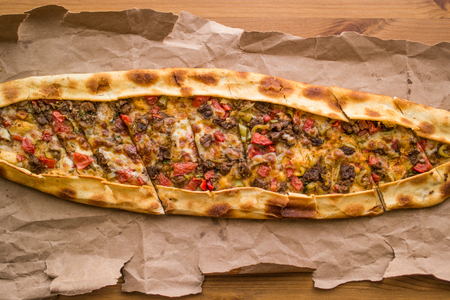 Turkish pide with cheese and cubed meat  kusbasili kasarli pide.