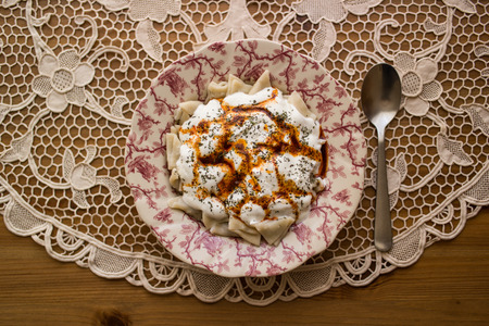 Turkish Manti Manlama  Ravioli with yogurt and fried butter sauce.