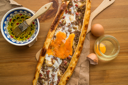 Turkish Pide with egg and minced meat.
