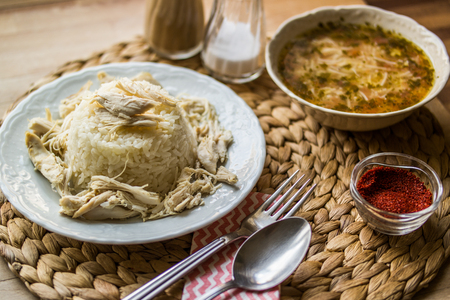 Turkish traditional chicken on a rise (tavuklu pilav or pilaf) and chicken broth soup Stok Fotoğraf - 94604740