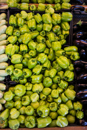 Fresh Green Peppers at greengrocer Stock Photo