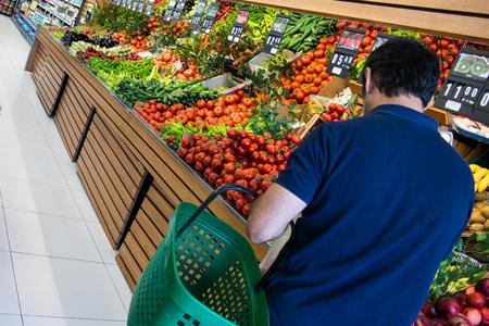 man is shopping at greengrocer
