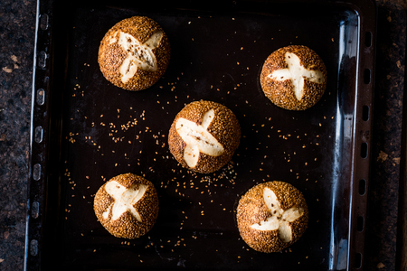 Freshly Baked Hot Cross Bun Bread with Sesames / Simit Roll. Traditional Food. Фото со стока