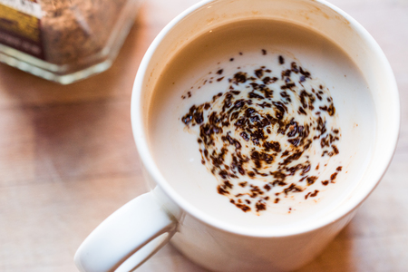 Instant Granulated Coffee Powder with Milk in Cup. Beverage Concept. Stock Photo