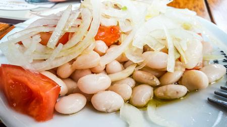 Turkish Piyaz Salad with onions and tomates. Traditional Salad.