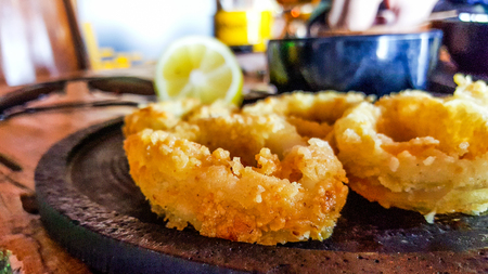 Fried Squid with lemon at the restaurant. seafood concept. Stok Fotoğraf