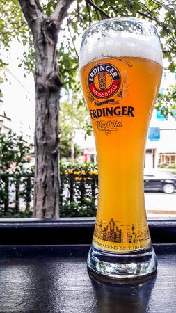 TURKEY, ISTANBUL - DECEMBER 29, 2016: Erdinger Beer Glass at garden of the pub. editorial content.