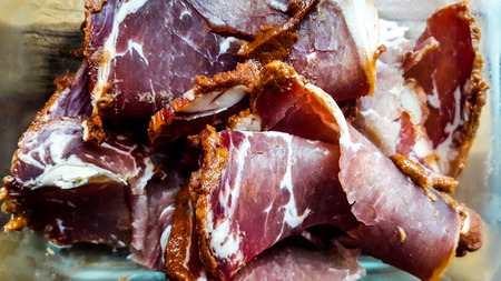 Turkish Pastirma or Pastrami in glass bowl. turkish smoked meat slices