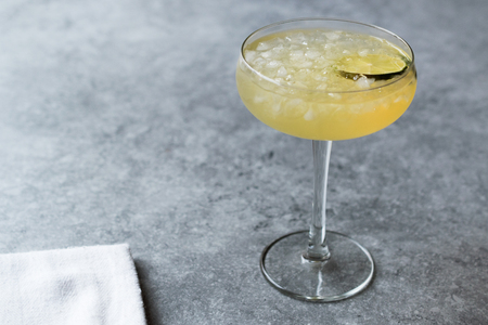 Gin Gimlet Cocktail with Lime and Crushed Ice. Beverage Concept.