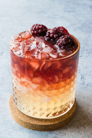Bramble Cocktail with Blackberries and Crushed Ice. Beverage Concept