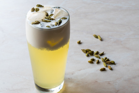 Cardamom Cocktail with Seeds, Cream and Ice. Beverage Concept. Stock Photo