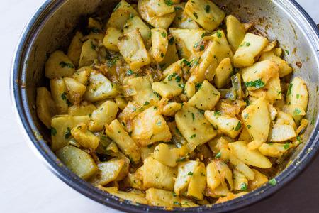 Fried Celery Slices with Parsley in Pan. Organic Food. Zdjęcie Seryjne