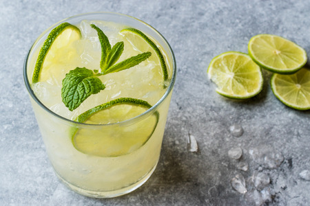 Fresh Lime Schorle Cocktail with Crush Ice. Beverage Concept.