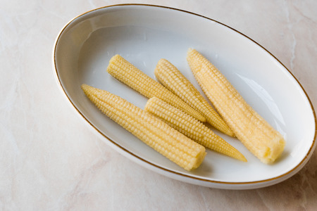 Sweet Baby Corn Pickle in Porcelain Bowl. Organic Food. Stock Photo - 98236772