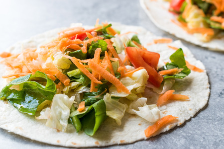 Homemade Vegetarian Tostadas with Salad and Polished Carrot Slices. FastFood. Stock Photo