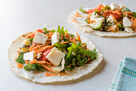 Homemade Vegetarian Tostadas with Salad, Cheese and Grated Carrot Slices. FastFood. Stock Photo