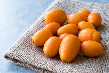Fresh Fruit Kumquat  Cumquat on a Sack. Organic Food. Stock Photo