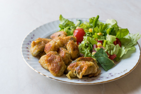 Fried Crispy Mussels Served with Salad. Organic Food. Stock Photo