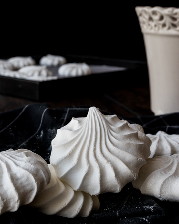 Meringue is a type of dessert, often associated with French, Swiss, and Italian cuisine, made from whipped egg whites (or aquafaba) and sugar, and occasionally an acidic ingredient such as lemon, vinegar or cream of tartar.