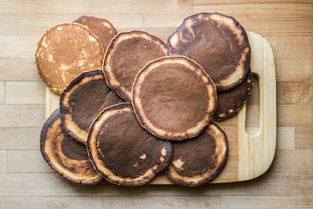 stack of pancakes on wooden surface Stock Photo