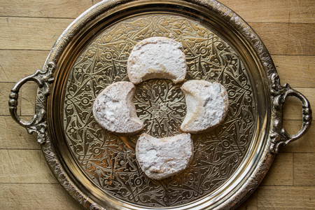 kavala cookies with powdered sugar in silver tray  powder