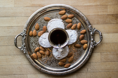 kavala cookies with almonds in silver tray with tea