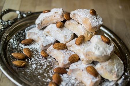 greek kavala cookies with almonds in silver tray Stok Fotoğraf