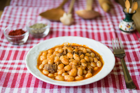 turkish baked beans dried beans on tablecloth Stock Photo