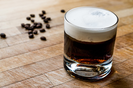 White Russian Cocktail with coffee beans. Beverage concept.