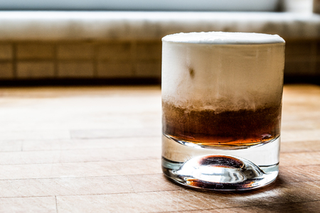 White Russian Cocktail on wooden surface. Beverage Concept. 스톡 콘텐츠