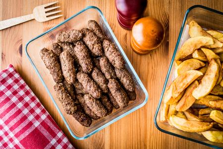 Tukish Meatballs Kuru Kofte with homemade potato wedges. homemade food concept.