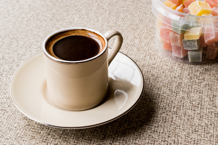 Turkish Coffee with Turkish Delight Kus Lokumu. Traditional beverage