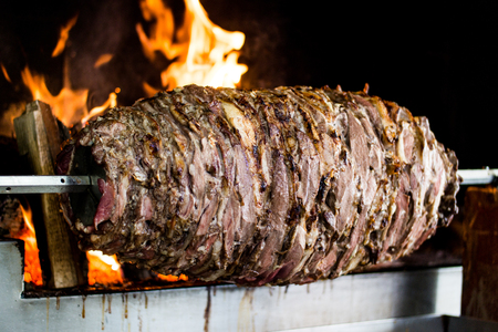 Turkish Cag Kebab Doner in wood fired oven. fast food
