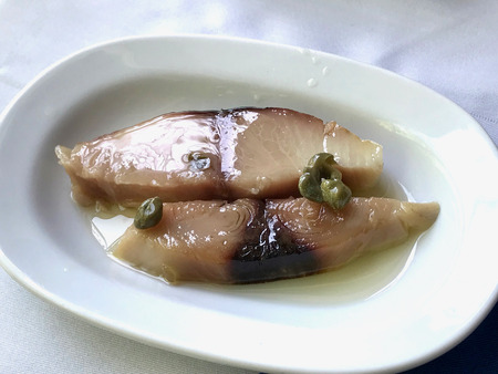 Turkish appetizer Pickled Tunny Fish with Olive Oil. Traditional Organic Food.