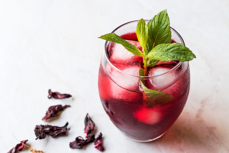 Cold Brew Hibiscus Tea with ice and Mint Leaves. Summer Beverage.