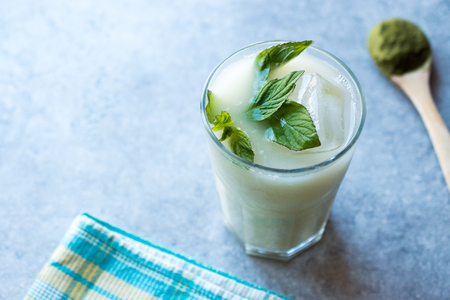 Iced Matcha Tea Latte with Mint Leaves. Smoothie Beverage. Stock Photo